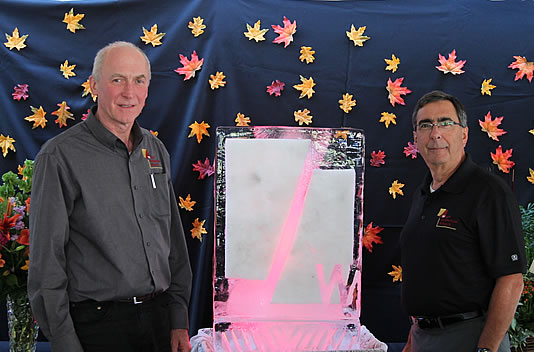 Walter Price, President (left) and Michael Buell, Executive Vice President (right) at WAM's 40th Anniversary party